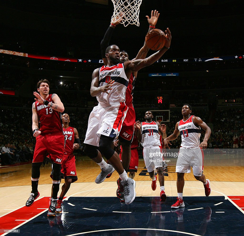 Martell Webster #9 of the Washington Wizards goes to the basket against LeBron James #6 of the Miami Heat during the game at the Verizon Center on December 4, 2012 in Washington, DC.