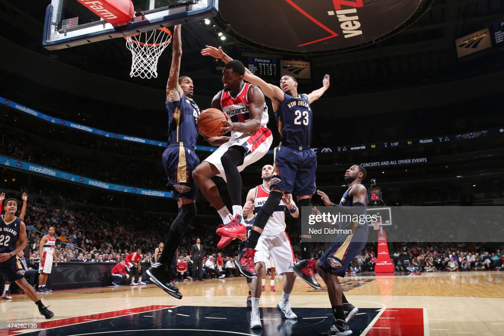 <a gi-track='captionPersonalityLinkClicked' href=/galleries/search?phrase=Martell+Webster&family=editorial&specificpeople=601785 ng-click='$event.stopPropagation()'>Martell Webster</a> #9 of the Washington Wizards goes to the basket against Anthony Davis #23 and Alexis Ajinca #42 of the New Orleans Pelicans during the game at the Verizon Center on February 22, 2014 in Washington, DC.