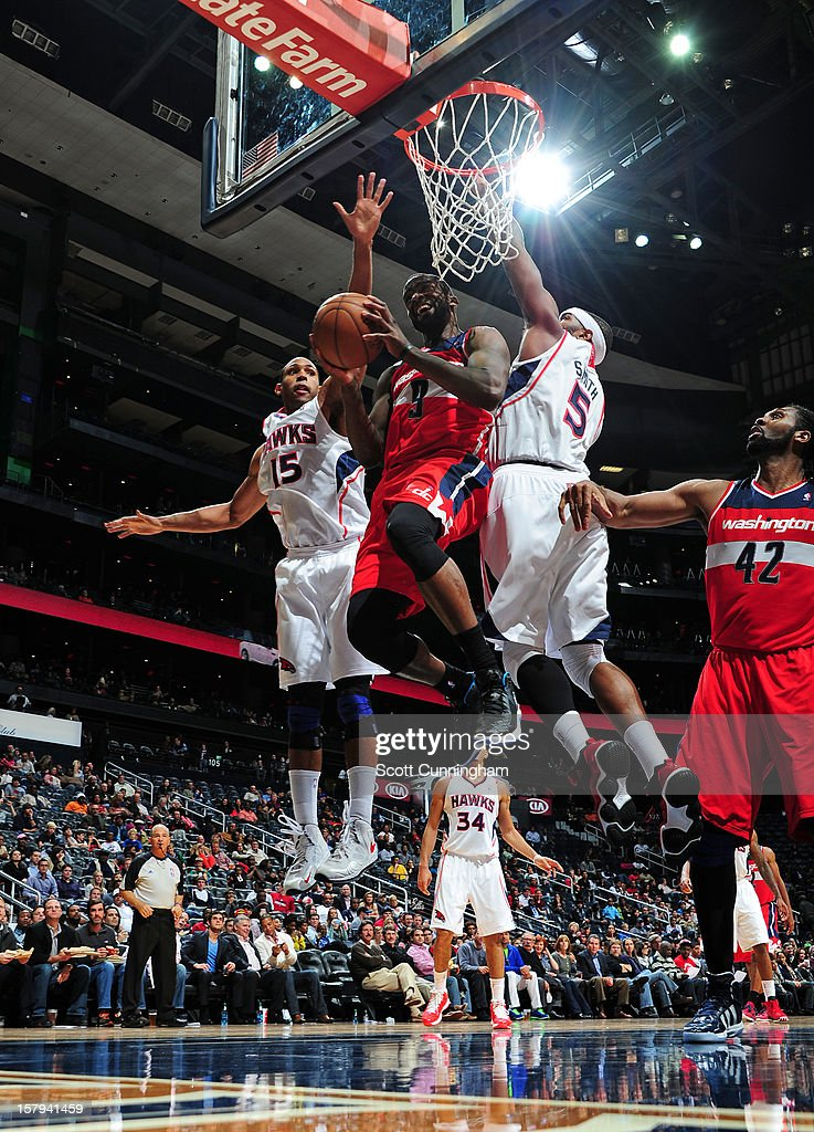 <a gi-track='captionPersonalityLinkClicked' href=/galleries/search?phrase=Martell+Webster&family=editorial&specificpeople=601785 ng-click='$event.stopPropagation()'>Martell Webster</a> #9 of the Washington Wizards goes up for a layup into traffic against the Atlanta Hawks at Philips Arena on December , 2012 in Atlanta, Georgia.