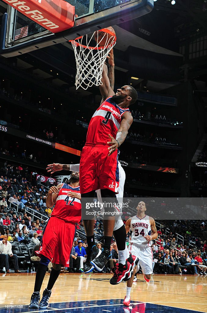 <a gi-track='captionPersonalityLinkClicked' href=/galleries/search?phrase=Martell+Webster&family=editorial&specificpeople=601785 ng-click='$event.stopPropagation()'>Martell Webster</a> #9 of the Washington Wizards goes up for the dunk against the Atlanta Hawks at Philips Arena on December , 2012 in Atlanta, Georgia.