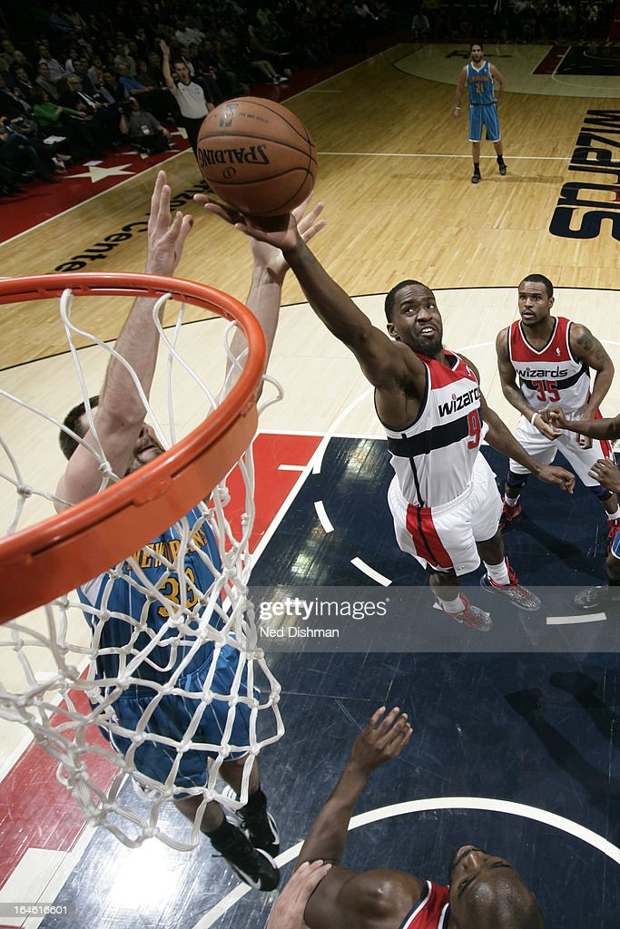 <a gi-track='captionPersonalityLinkClicked' href=/galleries/search?phrase=Martell+Webster&family=editorial&specificpeople=601785 ng-click='$event.stopPropagation()'>Martell Webster</a> #9 of the Washington Wizards grabs a rebound against the New Orleans Hornets at the Verizon Center on March 15, 2013 in Washington, DC.