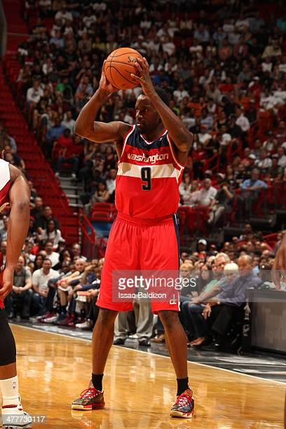 Martell Webster of the Washington Wizards looks to pass the ball against the Miami Heat at the American Airlines Arena in Miami Florida on March 10...
