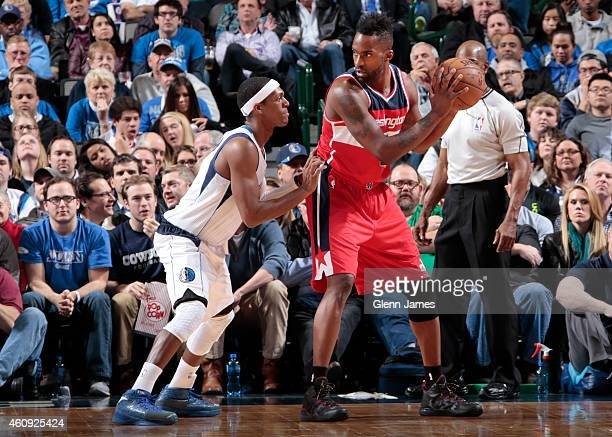 Martell Webster of the Washington Wizards posts up against Rajon Rondo of the Dallas Mavericks on December 30 2014 at the American Airlines Center in...