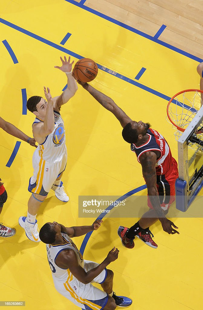 <a gi-track='captionPersonalityLinkClicked' href=/galleries/search?phrase=Martell+Webster&family=editorial&specificpeople=601785 ng-click='$event.stopPropagation()'>Martell Webster</a> #9 of the Washington Wizards rebounds against <a gi-track='captionPersonalityLinkClicked' href=/galleries/search?phrase=Klay+Thompson&family=editorial&specificpeople=5132325 ng-click='$event.stopPropagation()'>Klay Thompson</a> #11 of the Golden State Warriors on March 23, 2013 at Oracle Arena in Oakland, California.