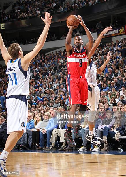 Martell Webster of the Washington Wizards shoots a jumper against Dirk Nowitzki of the Dallas Mavericks on December 30 2014 at the American Airlines...