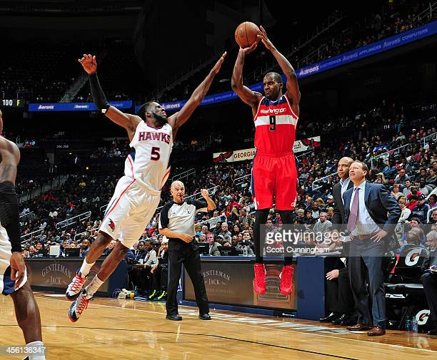 Martell Webster of the Washington Wizards shoots a three pointer against the Atlanta Hawks on December 13 2013 at Philips Arena in Atlanta Georgia...
