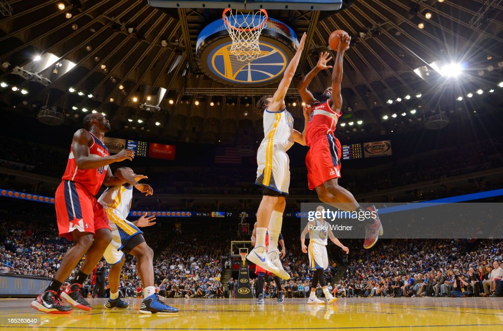 Martell Webster #9 of the Washington Wizards shoots against Andrew Bogut #12 of the Golden State Warriors on March 23, 2013 at Oracle Arena in Oakland, California.