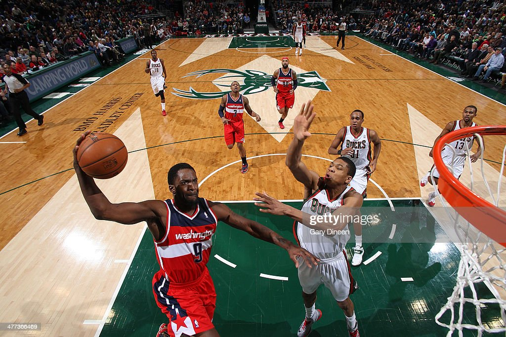 Martell Webster #9 of the Washington Wizards shoots against Giannis Antetokounmpo #34 of the Milwaukee Bucks on March 8, 2014 at the BMO Harris Bradley Center in Milwaukee, Wisconsin.