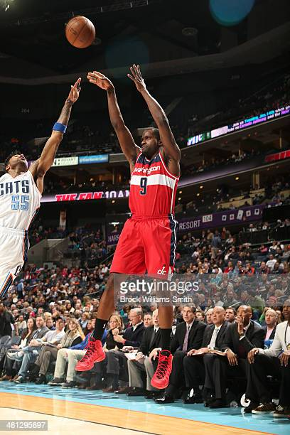 Martell Webster of the Washington Wizards shoots against the Charlotte Bobcats during the game at the Time Warner Cable Arena on January 7 2014 in...