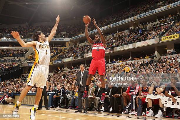 Martell Webster of the Washington Wizards shoots against the Indiana Pacers at Bankers Life Fieldhouse on November 29 2013 in Indianapolis Indiana...