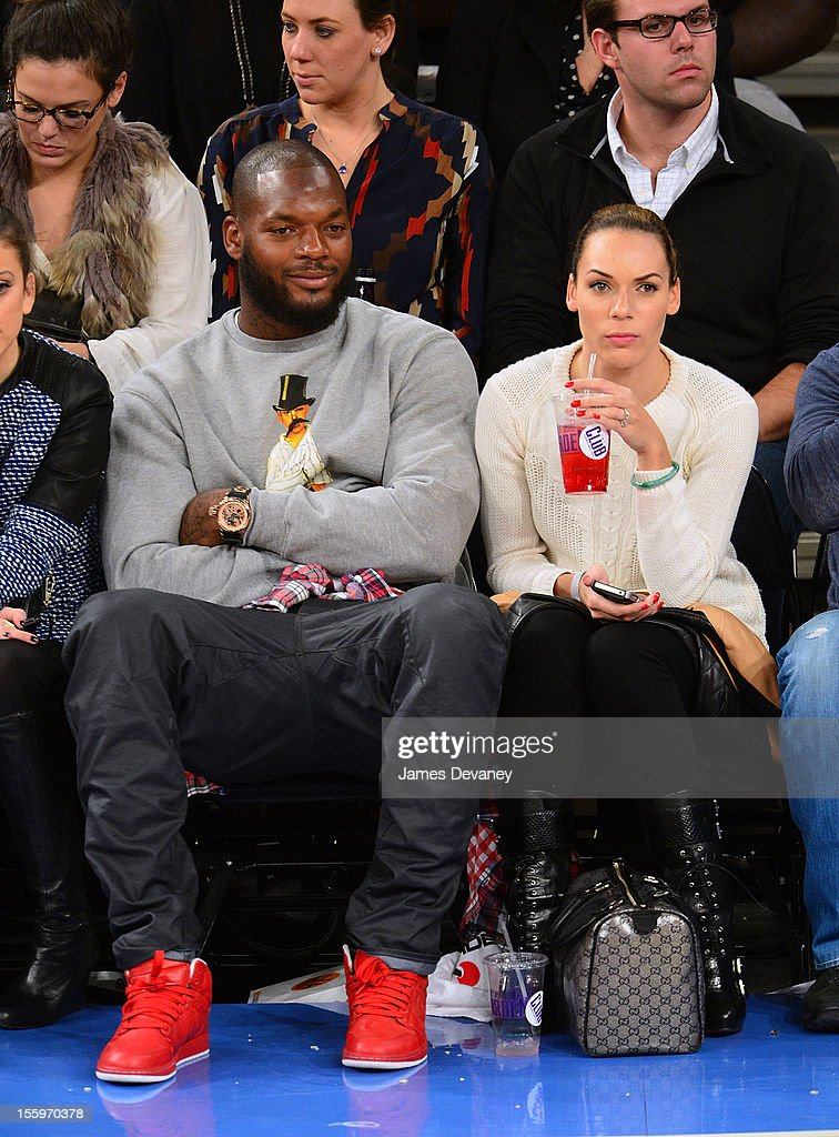 Martellus Bennet and guest attend the Dallas Mavericks vs New York Knicks game at Madison Square Garden on November 9, 2012 in New York City.