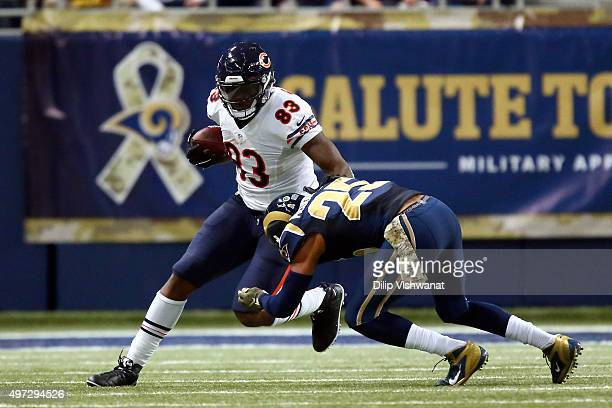 Martellus Bennett of the Chicago Bears carries the ball as TJ McDonald of the St Louis Rams attempts a tackle in the third quarter at the Edward...