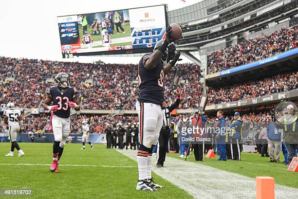 Martellus Bennett of the Chicago Bears celebrates after scoring a touchdown in the second quarter against the Oakland Raiders at Soldier Field on...