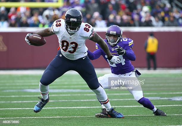 Martellus Bennett of the Chicago Bears gets tackled by Captain Munnerlyn of the Minnesota Vikings during the first quarter on December 28 2014 at TCF...