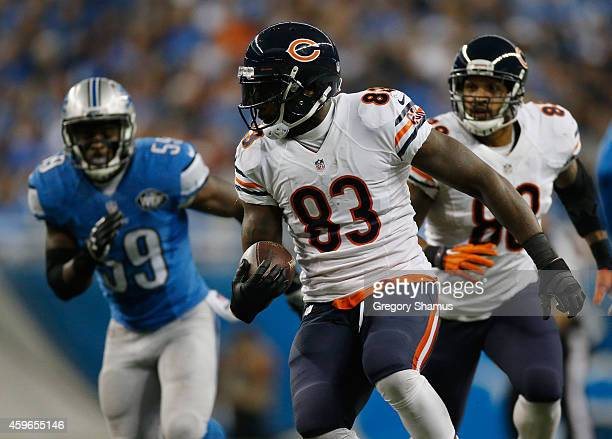 Martellus Bennett of the Chicago Bears looks to out run Tahir Whitehead of the Detroit Lions in the second quarter at Ford Field on November 27 2014...