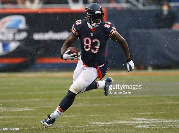 Martellus Bennett of the Chicago Bears runs with the ball during the first half of a game against the Minnesota Vikings at Soldier Field on November...