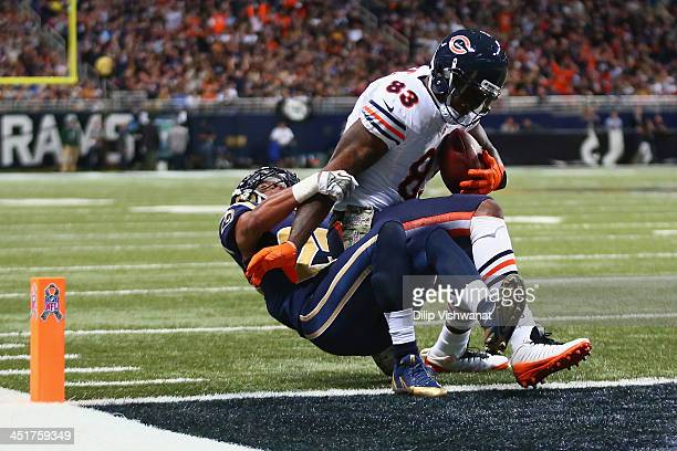 Martellus Bennett of the Chicago Bears scores a touchdown against TJ McDonald of the St Louis Rams at the Edward Jones Dome on November 24 2013 in St...