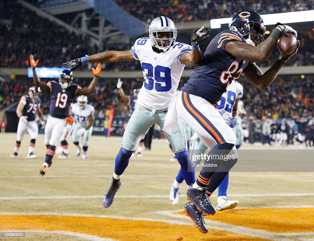 Martellus Bennett #83 of the Chicago Bears scores a touchdown over Brandon Carr #39 of the Dallas Cowboys during the second quarter of a game at Soldier Field on December 4, 2014 in Chicago, Illinois.