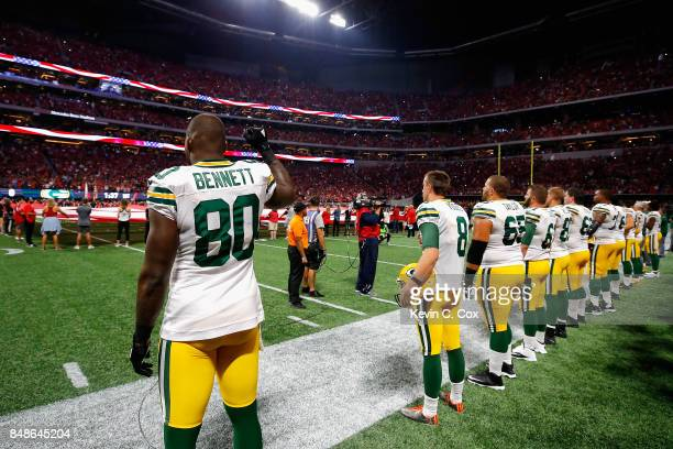 Martellus Bennett of the Green Bay Packers raises his fist during the national anthem prior to the game between the Green Bay Packers and the Atlanta...