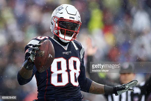 Martellus Bennett of the New England Patriots celebrates after scoring a touchdown against the New York Jets during the first half at Gillette...