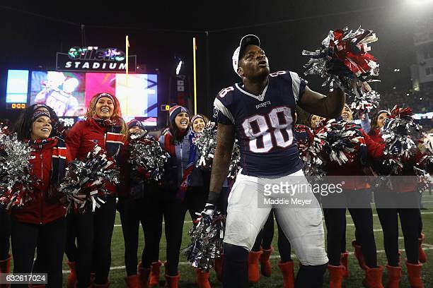 Martellus Bennett of the New England Patriots celebrates with cheerleaders after defeating the Pittsburgh Steelers 3617 to win the AFC Championship...