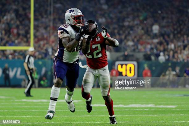 Martellus Bennett of the New England Patriots is tackled by Keanu Neal of the Atlanta Falcons in the fourth quarter during Super Bowl 51 at NRG...