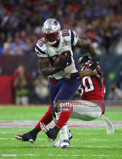 Martellus Bennett of the New England Patriots makes a catch against Deji Olatoye of the Atlanta Falcons in the second quarter during Super Bowl 51 at...