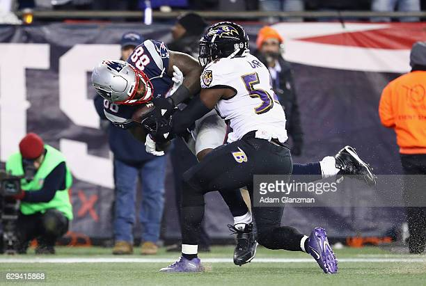 Martellus Bennett of the New England Patriots makes a touchdown reception against Zachary Orr of the Baltimore Ravens during the third quarter of...