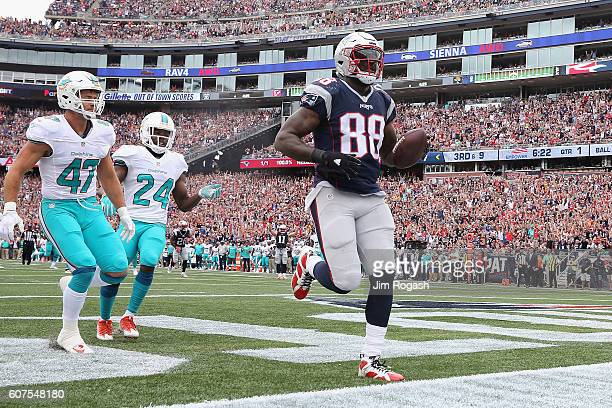 Martellus Bennett of the New England Patriots scores a touchdown during the first quarter against the Miami Dolphins at Gillette Stadium on September...