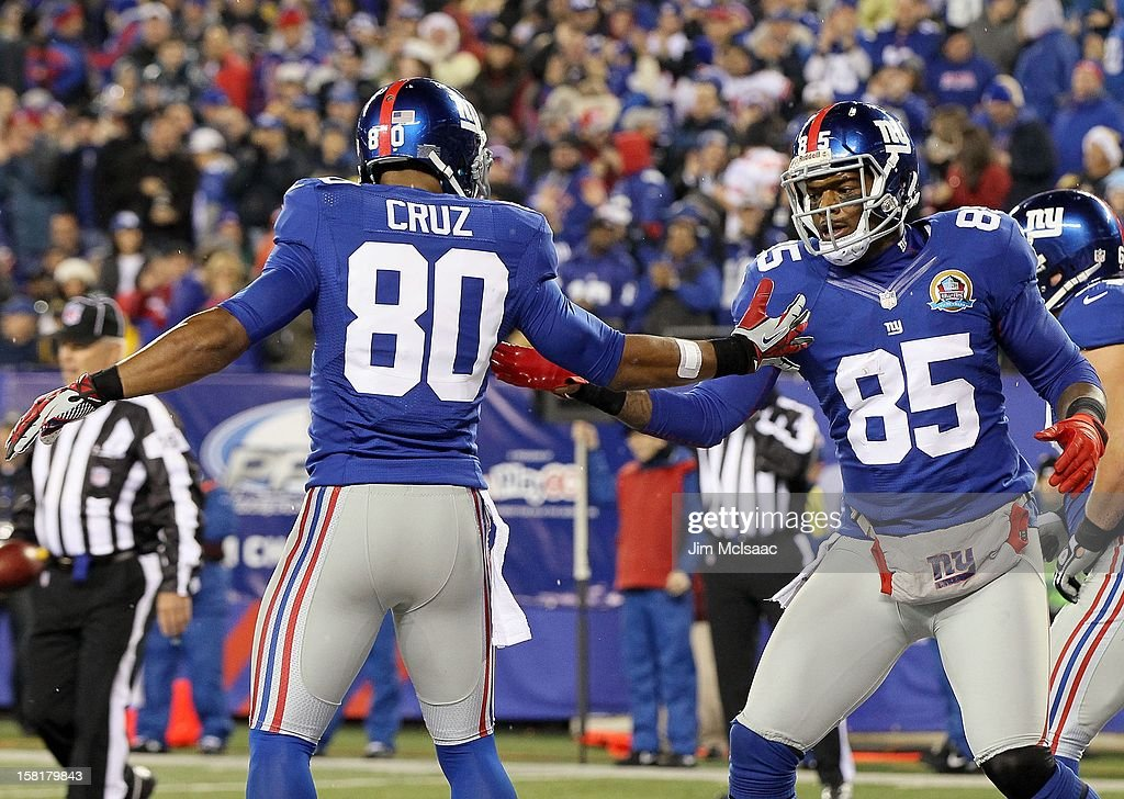 Martellus Bennett #85 of the New York Giants celebrates his touchdown against the New Orleans Saints with teammate Victor Cruz #80 at MetLife Stadium on December 9, 2012 in East Rutherford, New Jersey. The Giants defeated the Saints 52-27.