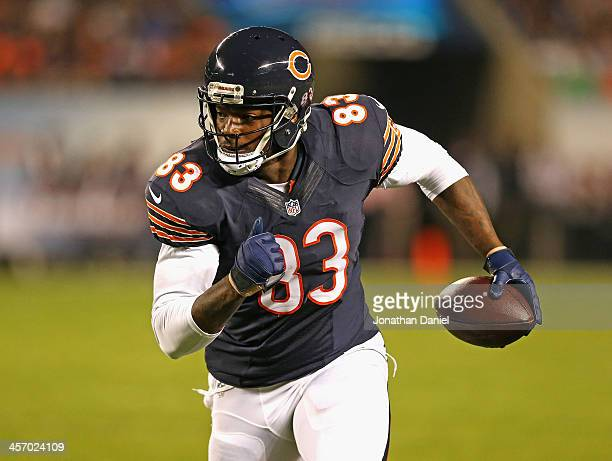 Martellus Bennett the Chicago Bears runs after a catch against the New York Giants at Soldier Field on October 10 2013 in Chicago Illinois The Bears...