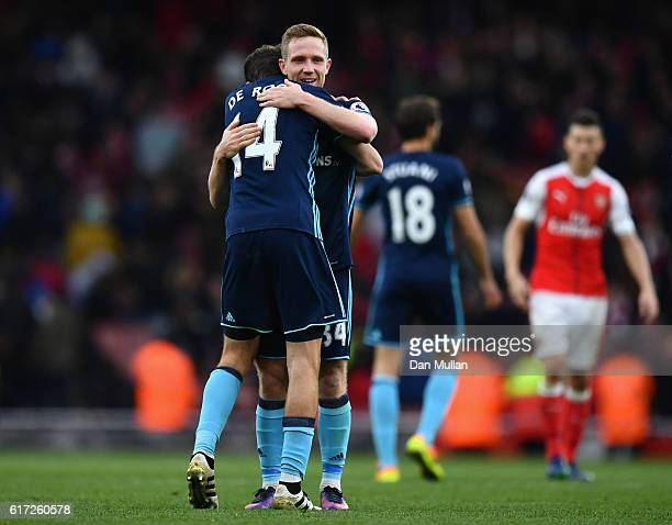 Marten de Roon and Adam Forshaw of Middlesbrough celebrate their draw after the Premier League match between Arsenal and Middlesbrough at Emirates...