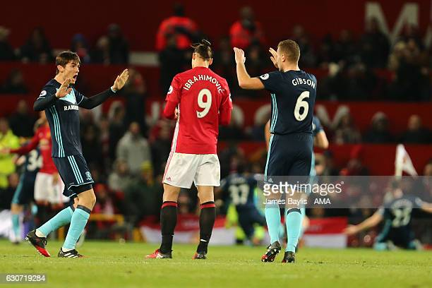 Marten de Roon and Ben Gibson of Middlesbrough celebrate after their team scored to make it 01 by a dejected Zlatan Ibrahimovic of Manchester United...