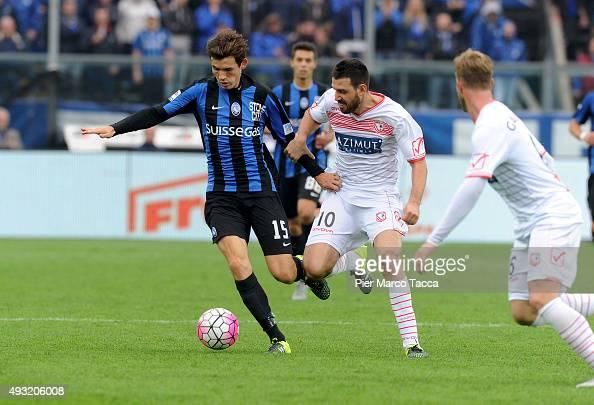 Marten De Roon of Atalanta BC competes for the ball with Andrea Lazzari of Carpi FC during the Serie A match between Atalanta BC and Carpi FC at...