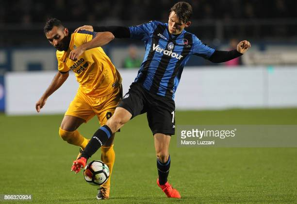 Marten De Roon of Atalanta BC competes for the ball with Mohamed Fares of Hellas Verona FC during the Serie A match between Atalanta BC and Hellas...