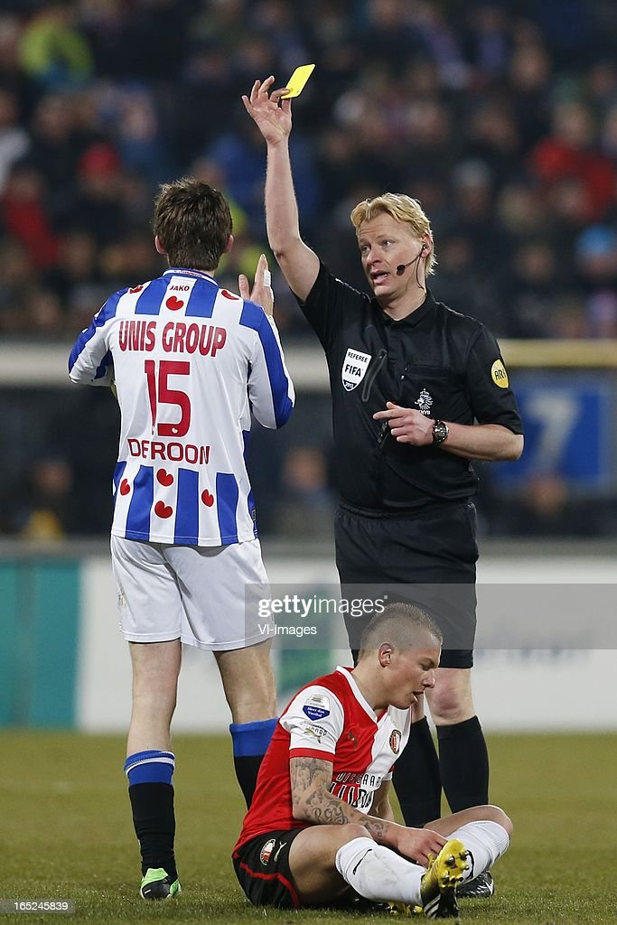 Marten de Roon of Heerenveen,Jordy Clasie of Feyenoord,referee Kevin Blom during the Dutch Eredivisie match between SC Heerenveen and Feyenoord at the Abe Lenstra Stadium on march 30, 2013 in Heerenveen, The Netherlands