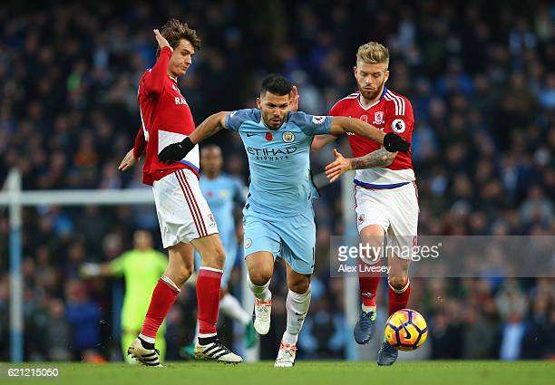 Marten de Roon of Middlesbrough and Adam Clayton of Middlesbrough puts pressure on Sergio Aguero of Manchester City during the Premier League match...