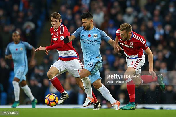 Marten de Roon of Middlesbrough and Calum Chambers of Middlesbrough put pressure on Sergio Aguero of Manchester City during the Premier League match...
