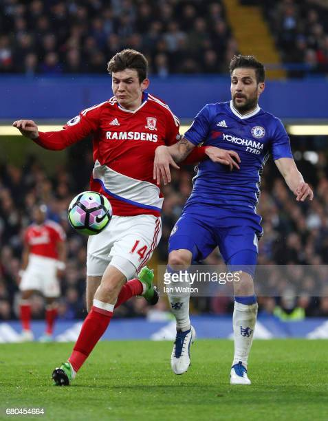 Marten de Roon of Middlesbrough and Cesc Fabregas of Chelsea in action during the Premier League match between Chelsea and Middlesbrough at Stamford...