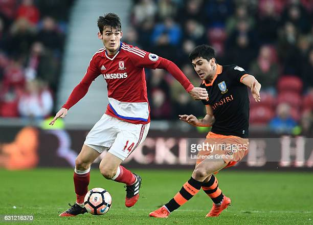 Marten de Roon of Middlesbrough and Fernando Forestieri of Sheffield Wednesday battle for possession during The Emirates FA Cup Third Round match...