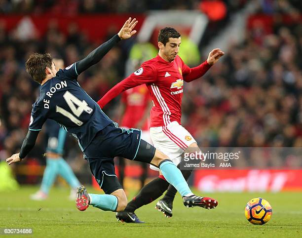 Marten de Roon of Middlesbrough and Henry Mkhitaryan of Manchester United during the Premier League match between Manchester United and Middlesbrough...