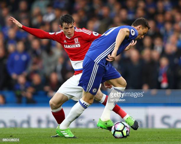 Marten de Roon of Middlesbrough and Nemanja Matic of Chelsea clash during the Premier League match between Chelsea and Middlesbrough at Stamford...