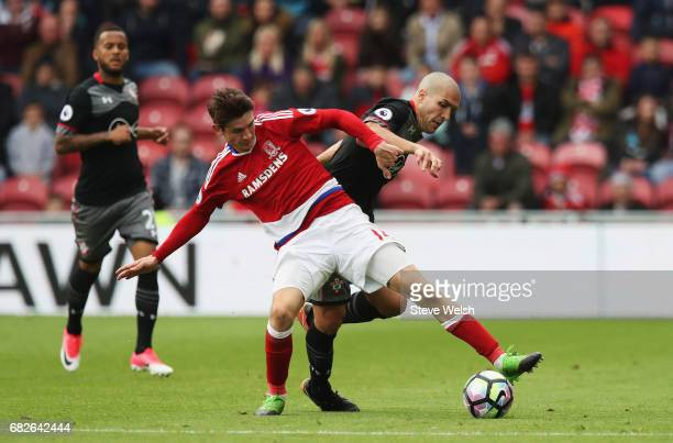 Marten de Roon of Middlesbrough and Oriol Romeu of Southampton battle for possession during the Premier League match between Middlesbrough and...