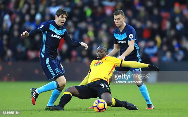 Marten de Roon of Middlesbrough and Stefano Okaka of Watford battle for possession during the Premier League match between Watford and Middlesbrough...