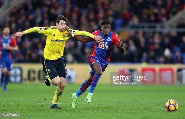 Marten de Roon of Middlesbrough and Wilfried Zaha of Crystal Palace battle for possession during the Premier League match between Crystal Palace and...