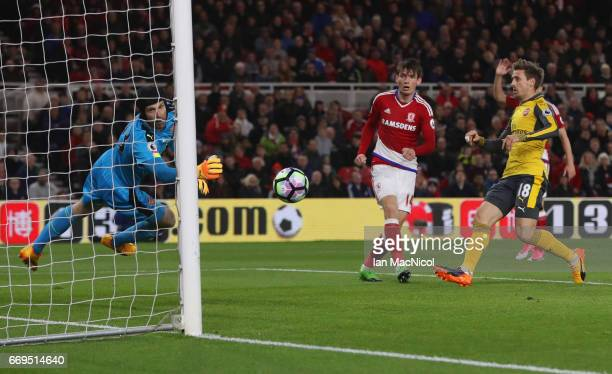 Marten de Roon of Middlesbrough heads past Petr Cech of Arsenal but the goal is disallowed during the Premier League match between Middlesbrough and...