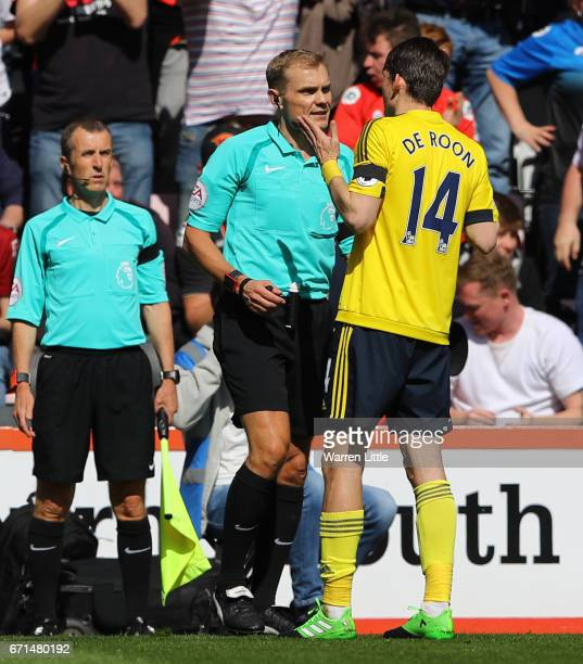 Marten de Roon of Middlesbrough protests the red card of Gaston Ramirez of Middlesbrough during the Premier League match between AFC Bournemouth and...