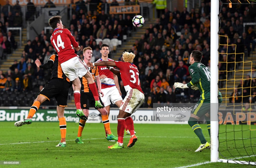 Marten de Roon of Middlesbrough (L) scores his sides second goal during the Premier League match between Hull City and Middlesbrough at the KCOM Stadium on April 5, 2017 in Hull, England.