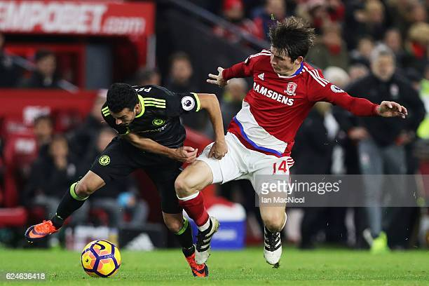 Marten de Roon of Middlesbrough tackles Pedro of Chelsea during the Premier League match between Middlesbrough and Chelsea at Riverside Stadium on...