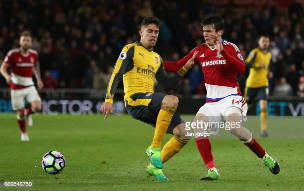 Marten de Roon of Middlesbrough takes on Gabriel of Arsenal during the Premier League match between Middlesbrough and Arsenal at Riverside Stadium on...